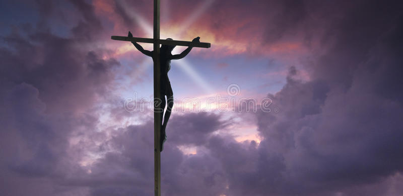 jesus-christ-cross-sunset-clouds-as-background-44608949