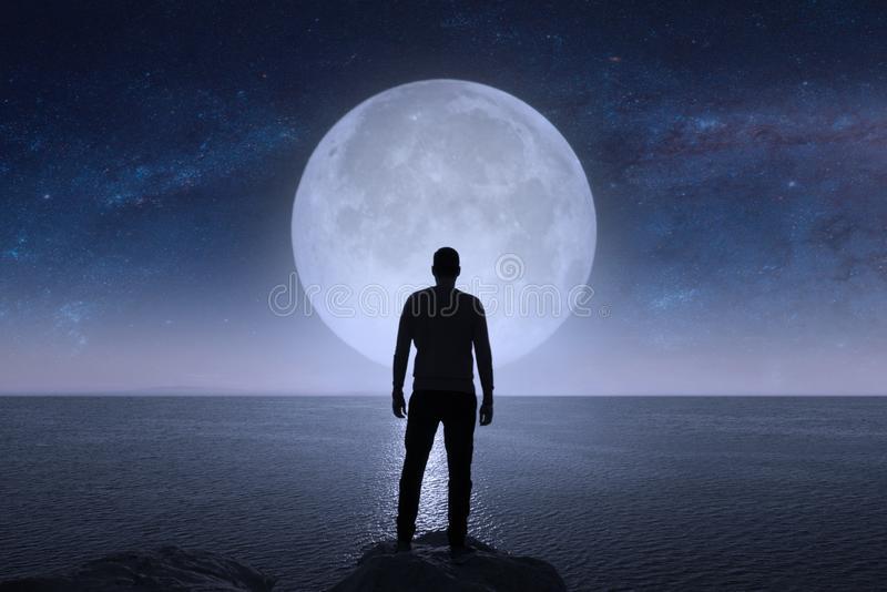 man-looks-stars-moon-elements-image-furnished-nasa-man-looks-stars-moon-114311078.jpg
