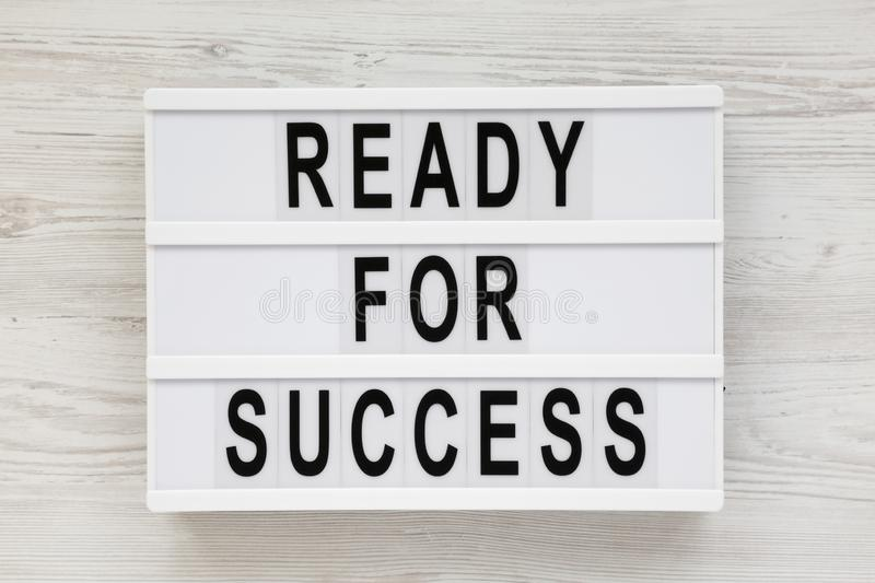 ready-success-words-modern-board-white-wooden-background-overhead-above-flat-lay-163537452